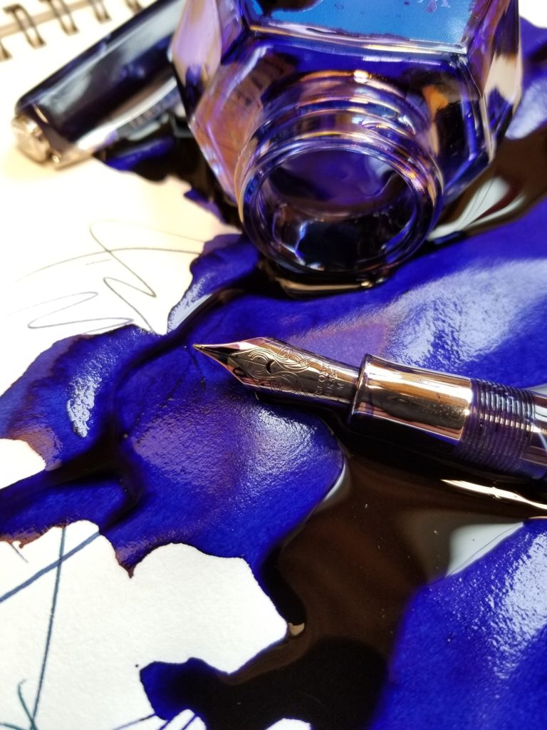 close up photo of spoiled blue ink with fountain pen
